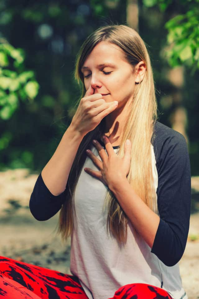 a-woman-practicing-breathing-technique-yoga-alternate-nostril